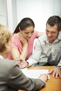 Homebuyers Working on their purchase offer