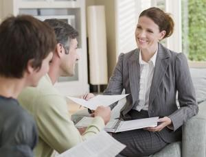 Home buyers working with a local real estate agent